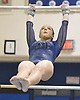 Miranda Lund of Plainview JFK performs on the uneven bars during the Nassau County varsity gymnastics individual championships and state qualifier at Long Beach High School on Tuesday, Feb. 13, 2018. She scored a 9.35 in the event.