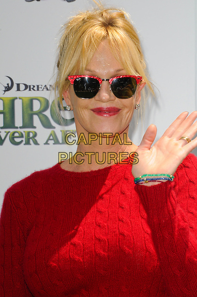 "MELANIE GRIFFITH .at DreamWorks Animation's ""Shrek Forever After"" L.A. Film Premiere held at Gibson Amphitheatre at Universal CityWalk, Universal City, California, USA, May 16th, 2010. .arrivals portrait headshot red jumper cable knit sweater ray bans sunglasses wayfarers hand waving .CAP/ROT.©Lee Roth/Capital Pictures"