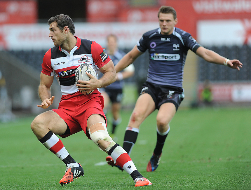 Edinburgh&rsquo;s Tim Visser in action during today's match <br /> <br /> Photographer Ashley Crowden/CameraSport<br /> <br /> Rugby Union - Guinness PRO12 - Ospreys v Edinburgh Rugby - Sunday 21st September 2014 - The Liberty Stadium - Swansea<br /> <br /> &copy; CameraSport - 43 Linden Ave. Countesthorpe. Leicester. England. LE8 5PG - Tel: +44 (0) 116 277 4147 - admin@camerasport.com - www.camerasport.com