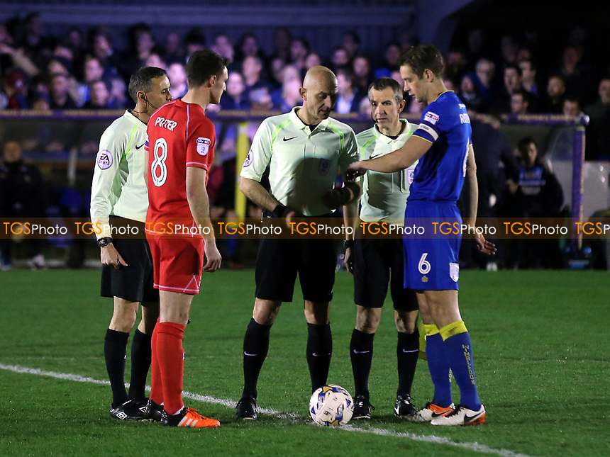 The two captains with referee, Roger East, prior to kick-off  during AFC Wimbledon vs MK Dons, Sky Bet EFL League 1 Football at the Cherry Red Records Stadium on 14th March 2017