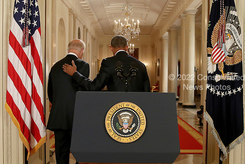 United States President Barack Obama and Vice President Joe Biden walk away from the podium after President Obama delivered remarks in the East Room of the White House in Washington, Tuesday, July 14, 2015, after an Iran nuclear deal is reached. After 18 days of intense and often fractious negotiation, diplomats Tuesday declared that world powers and Iran had struck a landmark deal to curb Iran's nuclear program in exchange for billions of dollars in relief from international sanctions.<br /> Credit: Andrew Harnik / Pool via CNP