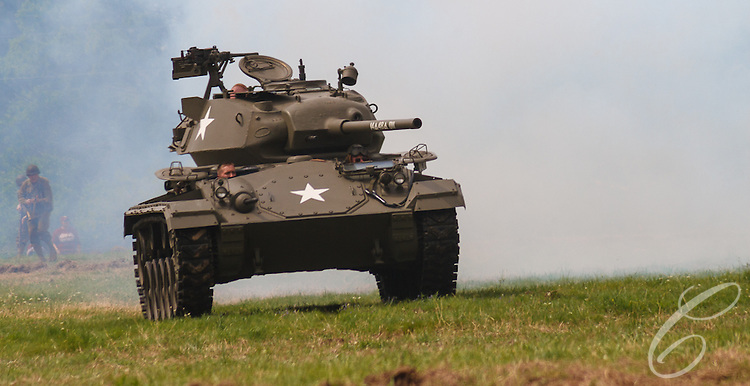 Reenactors showcase World War II tanks, half-tracks and support vehicles during the Museum of the America G.I.'s annual Open House on March 29, 2008 in College Station, Texas. A M24 Chaffee light tank emerges from the smoke.