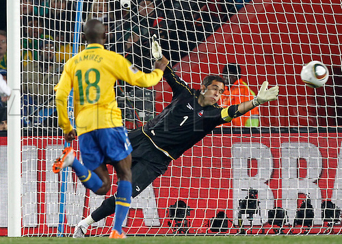 28 06 2010    FIFA World Cup 2010   Brazil vs Chile Picture shows Ramires BRA watches as Robhino's shot goes past Claudio Bravo CHI for Brazils 3rd goal.