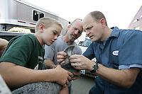 Kodi Kelley, 11, dad Tim Kelley, of Deming, and veterinarian Kevin Erickson, right, NW Washington Fair. August 16, 2009...