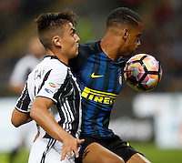 Calcio, Serie A: Inter vs Juventus. Milano, stadio San Siro, 18 settembre 2016.<br /> Juventus&rsquo; Paulo Dybala, left, and Inter's Senna Milangue fight for the ball during the Italian Serie A football match between FC Inter and Juventus at Milan's San Siro stadium, 18 September 2016.<br /> UPDATE IMAGES PRESS/Isabella Bonotto