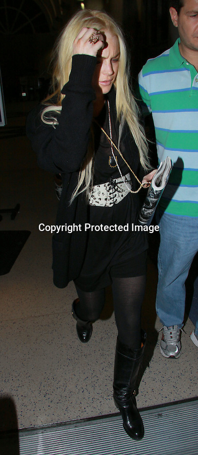 10-19-09  Midnight Sunday night..Lindsay Lohan wearing all black with a white belt as she was arriving to the Los Angeles airport to fly to New york city. ..ABILITYFILMS@YAHOO.COM.805-427-3519.www.AbilityFilms.com