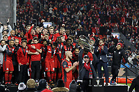 Toronto, Ontario - Saturday December 09, 2017: Larry Tanenbaum holds the Philip F. Anschutz Trophy overhead before handing it to Michael Bradley. Toronto FC defeated the Seattle Sounders FC 2-0 in MLS Cup 2017, Major League Soccer's (MLS) championship game played at BMO Field.