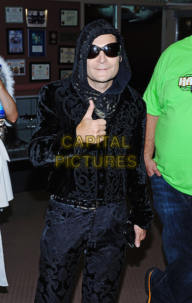 01 October 2016 - Hamilton, Ontario, Canada.  Actor/singer Corey Feldman with girlfriend 'Angel' Courtney Anne Mitchell at Hamilton Comic Con at the Canadian Warplane Heritage Museum. <br /> CAP/ADM/BPC<br /> &copy;BPC/ADM/Capital Pictures