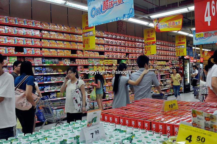 Shoppers in a supermarket in Guangzhou, China. The financial crisis won't have too much impact on Chinese consuming market. According to a survey by Nielsen of 50 countries and regions, only 35 percent of Chinese people believed the domestic economy was in a contraction. The figure was the lowest among the 50 world markets..27 Jun 2009