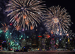 (Boston, MA, 01/01/18) Midnight fireworks burst over Boston Harbor as the city ushers in the New Year on Monday, January 01, 2018. Staff photo by Christopher Evans