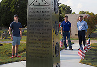 NWA Democrat-Gazette/CHARLIE KAIJO Casey McKirch, 16, of Gentry (from left), Kalvin Newberry of Springdale and Michael Parker, president of Nabholz Construction, admire a new monument during a dedication ceremony, Monday, September 9, 2019 at the Rogers cemetery in Rogers.<br /> <br /> The Rogers Cemetery held a dedication ceremony for its new monument.