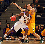 SIOUX FALLS, SD - MARCH 11:  Adam Link #33 from Western Illinois University backs into Marshall Bjorklund #42 from North Dakota State University in the second half or their semifinal game Monday night at the 2013 Summit League Championship in Sioux Falls, SD.  (Photo by Dave Eggen/Inertia)