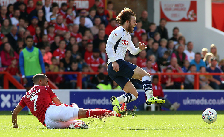 Preston North End's Ben Pearson is tackled by Nottingham Forest's Lewis Grabban<br /> <br /> Photographer David Shipman/CameraSport<br /> <br /> The EFL Sky Bet Championship - Nottingham Forest v Preston North End - Saturday 31st August 2019 - The City Ground - Nottingham<br /> <br /> World Copyright © 2019 CameraSport. All rights reserved. 43 Linden Ave. Countesthorpe. Leicester. England. LE8 5PG - Tel: +44 (0) 116 277 4147 - admin@camerasport.com - www.camerasport.com