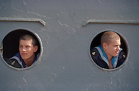 Saint Petersburg, Russia, 28/07/2002..Two sailors look forward to shore leave from their battleship which has just arrived in port. Peter the Great founded the Russian Navy, and St Petersburg remains the home of the fleet. Navy Day brings the ships to port and the sailors to shore.......