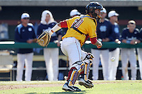 Jake Hernandez, #20, of the USC Trojans in the field against the North Carolina Tar Heels at Dedeaux Field on February 20, 2011 in Los Angeles,California. Photo by Larry Goren/Four Seam Images