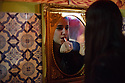 Lisbon, Portugal. 05.05.2015. Ana Catarina Grilo, Fadista, applies her make-up before singing in restaurant Coracao de Alfama, where she is a resident performer. Photograph © Jane Hobson.