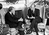 "United States President Gerald R. Ford, right, meets U.S. President Elect Jimmy Carter, left, in the Oval Office of the White House in Washington, D.C. to discuss the transition on November 22, 1976.  This is the first meeting between the two men since the Presidential debates during the campaign.<br /> Credit: Benjamin E. ""Gene"" Forte / CNP"