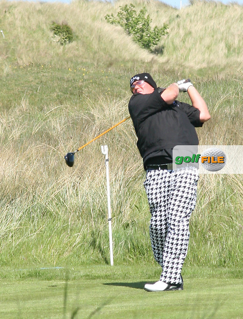 John Daly who shared second place at the Italian Open on Sunday has a practice round for the Irish Open at Co. Louth Golf Club in Baltray...Photo NEWSFILE/Jenny Matthews.(Photo credit should read Jenny Matthews/NEWSFILE)....This Picture has been sent you under the condtions enclosed by:.Newsfile Ltd..The Studio,.Millmount Abbey,.Drogheda,.Co Meath..Ireland..Tel: +353(0)41-9871240.Fax: +353(0)41-9871260.GSM: +353(0)86-2500958.email: pictures@newsfile.ie.www.newsfile.ie.FTP: 193.120.102.198.
