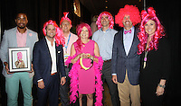 NWA Democrat-Gazette/CARIN SCHOPPMEYER Nick Glover, representing Tony Engle (from left), Ben Blakeman, Nick Berkeley, Paige Partridge, Kevin Springate, Curt Stamp and Tina Winham, Big Wigs, gather at the Pink Ribbon Luncheon on Thursday.