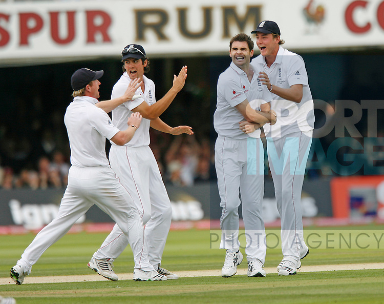 England's James Anderson celebrates getting Phil Hughes out for 4