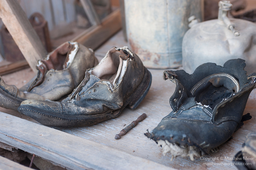 The Vulture Gold Mine, Vulture City, Arizona; old shoes sit on a table near a window inside the Assay Office, built in 1884 out of ore from the mine, it's walls contain over $600 thousand in gold and silver