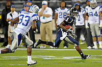 4 December 2010:  FIU wide receiver Willis Wright (1) evades Middle Tennessee safety Kevin Brown (33) after a reception in the second quarter as the Middle Tennessee State University Blue Raiders defeated the FIU Golden Panthers, 28-27, at FIU Stadium in Miami, Florida.