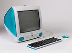 iMac Computer With Keyboard And Mouse, 1999; Designed by Apple Industrial Design Team and Jonathan Ive; China; molded plastic, rubber, glass, metal, electronic components; H x W x D (a: computer/monitor): 38 x 38.5 x 42.5 cm (14 15/16 x 15 3/16 x 16 3/4 in.) H x W x D (b: keyboard): 4 x 39.2 x 14 cm (1 9/16 x 15 7/16 x 5 1/2 in.) H x diam. (c: mouse): 42.5 x 8 cm (16 3/4 x 3 1/8 in.); Gift of Apple Computer; 2000-63-1-a/c; Cooper Hewitt, Smithsonian Design Museum. <br />