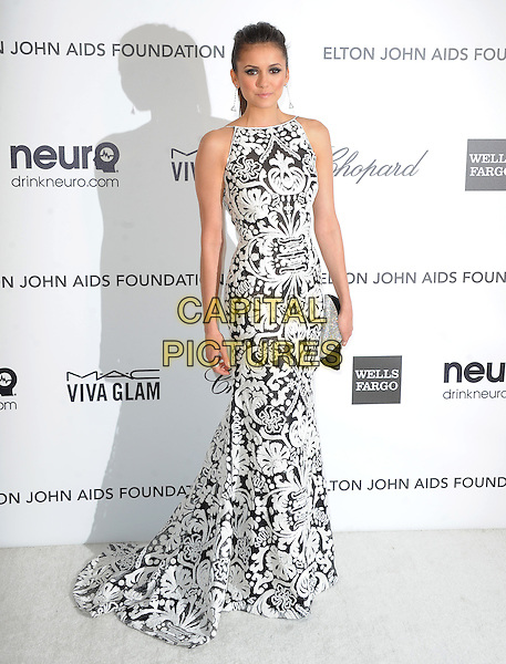 Nina Dobrev.The 21st Annual Elton John AIDS Foundation Academy Awards Viewing Party held at The City of West Hollywood Park in West Hollywood, California, USA..February 24th, 2013.oscars full length sleeveless dress white silver diamante black clutch pattern embroidered  .CAP/DVS.©DVS/Capital Pictures.