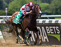 ELMONT, NY - JUNE 10: Songbird #5, ridden by Mike Smith, wins the Ogden Phipps Stakes on Belmont Stakes Day at Belmont Park on June 10, 2017 in Elmont, New York (Photo by Jesse Caris/Eclipse Sportswire/Getty Images)