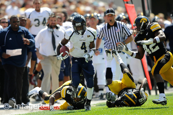 6 September 2008:  FIU wide receiver TY Hilton (4) evades Iowa defensive back Diauntae Morrow (3) and defensive back Amari Spievey (19) with linebacker Jeremiha Hunter (42) in pursuit in the second half of the Iowa 42-0 victory over FIU at Kinnick Field in Iowa City, Iowa.