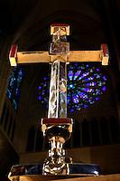 A l'église Sainte Clotilde de Paris, 7eme arrondissement, le 19 janvier 2011, Goudji remet la croix créée par ses soins au Père Matthieu Rougé, curé de la paroisse. Vue en contre-plongée de la croix avec le choeur de l'église en arrière-plan. In the Church Sainte Clotilde of Paris, in the 7th arrondissement, on January 19th, 2011, Goudji delivers the cross that he has created for the church to the priest Matthieu Rougé. Low angle view of the cross with the choir of the church in the background. Born in Georgia in 1941, Goudji has lived in Paris since 1974, due to the personal intervention of President Georges Pompidou. Here he produces his numerous contemporary works of goldsmithery in such widely differing fields as Church Art, swords, jewellery and sculpture. Picture by Manuel Cohen - Further clearance required, please contact us