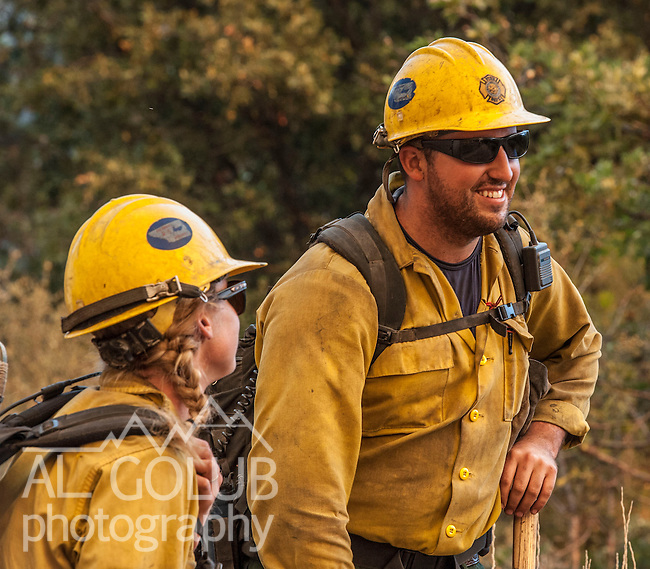 Rio Bravo Hotshots from Kern County watch fire along State Route 120.