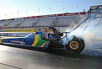 Feb. 14, 2013; Pomona, CA, USA; NHRA top fuel dragster driver Sidnei Frigo during qualifying for the Winternationals at Auto Club Raceway at Pomona.. Mandatory Credit: Mark J. Rebilas-