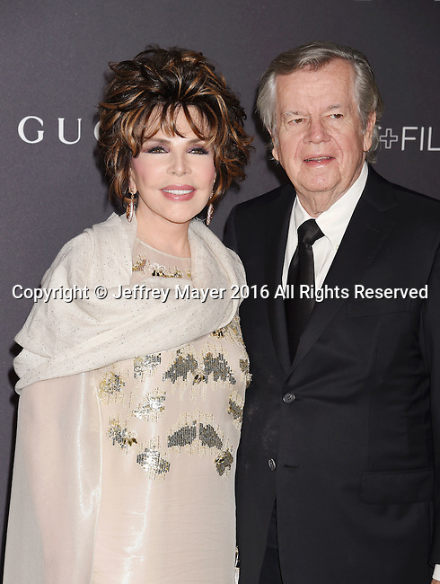 LOS ANGELES, CA - OCTOBER 29: LACMA Trustee/songwriter Carole Bayer Sager (L) and business executive Robert Daly attend the 2016 LACMA Art + Film Gala honoring Robert Irwin and Kathryn Bigelow presented by Gucci at LACMA on October 29, 2016 in Los Angeles, California.