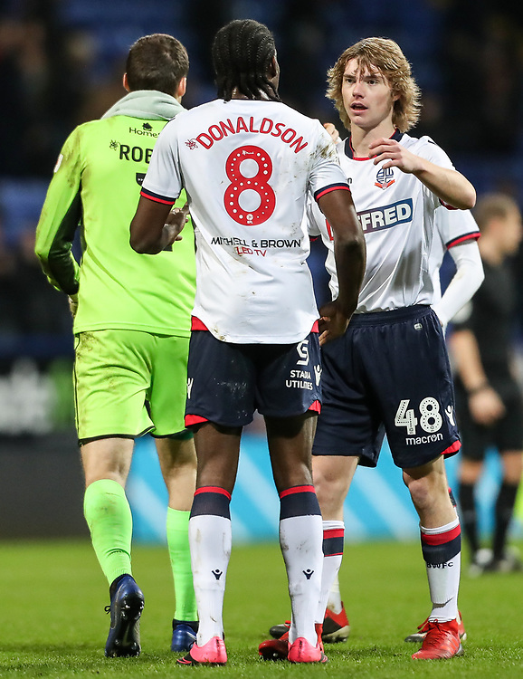 Bolton Wanderers' Luca Connell shakes hands with team mate Clayton Donaldson at the end of the match<br /> <br /> Photographer Andrew Kearns/CameraSport<br /> <br /> Emirates FA Cup Third Round - Bolton Wanderers v Walsall - Saturday 5th January 2019 - University of Bolton Stadium - Bolton<br />  <br /> World Copyright © 2019 CameraSport. All rights reserved. 43 Linden Ave. Countesthorpe. Leicester. England. LE8 5PG - Tel: +44 (0) 116 277 4147 - admin@camerasport.com - www.camerasport.com
