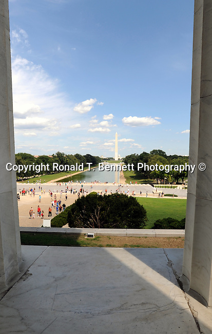 Washington Monument reflecting pool and US Capitol from pillars on Lincoln Memorial Washington DC, Washington Monument and flags Washington DC, Washington Monument,US Capital, United States Capital with flags, US flags, Lincoln memorial and washington monumnet, Washington DC, District, DC, capital, Potomac River, Washington Metropolitain, metropolitan area, federal district, federal government of USA, US Congress, White House, National Mall, Politics in the United States, Presidential, Federal Republic, united States Congress, powers, Judicial Power, House of Representatives, US Senate, Consitiution, federal law, Democratic Party, Republican party, two party system, Fine Art Photography by Ron Bennett, Fine Art, Fine Art photo, Art Photography,