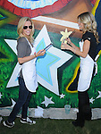 Jenny McCarthy & AnnaLynne McCord at the Pepsi Refresh Project Mural Painting at El Salvadore Community Center in Santa Ana, California on July 13,2010                                                                               © 2010 Debbie VanStory / Hollywood Press Agency