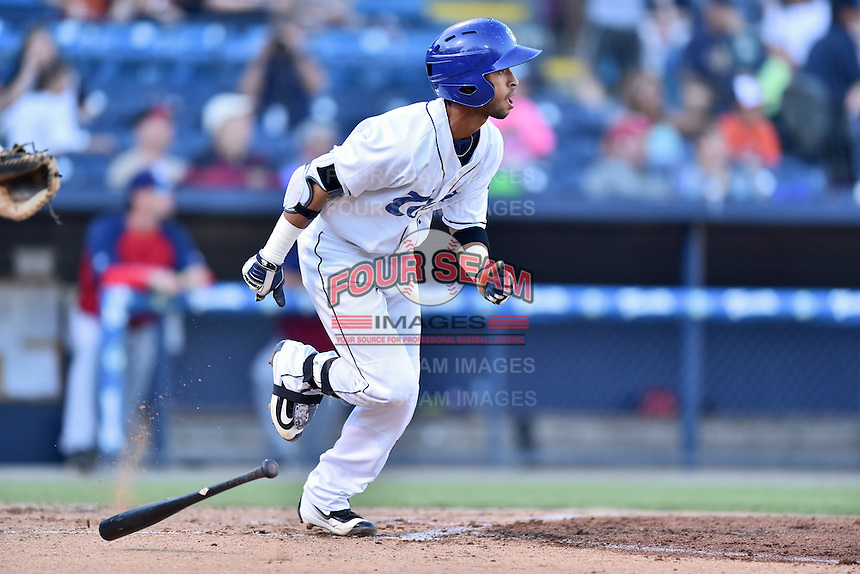 Asheville Tourists second baseman Carlos Herrera (4) runs to first base during a game against the Hagerstown Suns at McCormick Field on June 8, 2016 in Asheville, North Carolina. The Tourists defeated the Suns 10-8. (Tony Farlow/Four Seam Images)