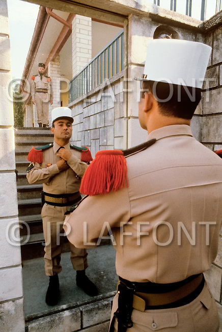 July, 1980, Aubagne, France. According to stricts rules, each legionnaire before leaving the quarter has to inspect himself in front of a mirror.