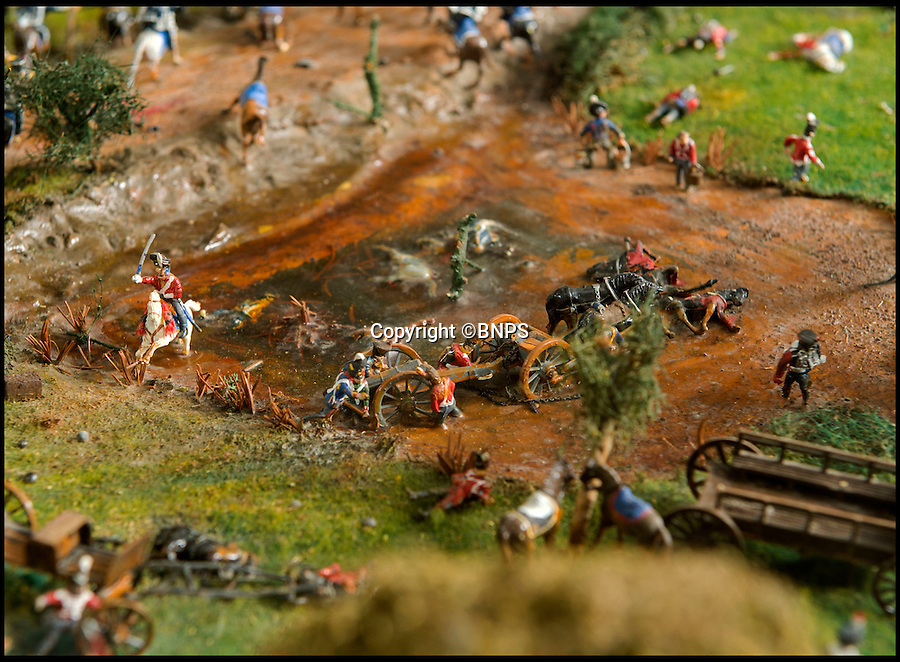 BNPS.co.uk (01202 558833)<br /> Pic: PhilYeomans/BNPS<br /> <br /> Incredible detail showing men, carts and horses stuck in a muddy pit.<br /> <br /> Historic battle brought back to life...<br /> <br /> A stunning diorama of the battle of Waterloo has been restored to its former glory after a painstaking cleaning operation to remove nearly 50 years of dust.<br /> <br /> The sweeping panorama contain's 21,500 figures and nearly 10,000 horses, each of which has been meticulously cleaned by hand over the last five months by husband and wife team Kelvin and Mary Thatcher from Norfolk.<br /> <br /> The pristine model has now gone back on display at the refurbished Royal Green jackets museum in Winchester.<br /> <br /> A sobering fact is that there were over twice as many casualties in the actual battle as there are figures on the diorama.