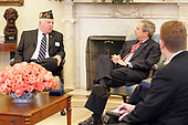 Washington, D.C. - March 14, 2005 -- United States President George W. Bush meets with John Furgess, the National Commander-in-Chief of the Veterans of Foreign Wars, in the Oval Office at the White House in Washington, D.C. on Monday, March 14, 2005.<br /> Mandatory Credit: Krisanne Johnson - White House via CNP