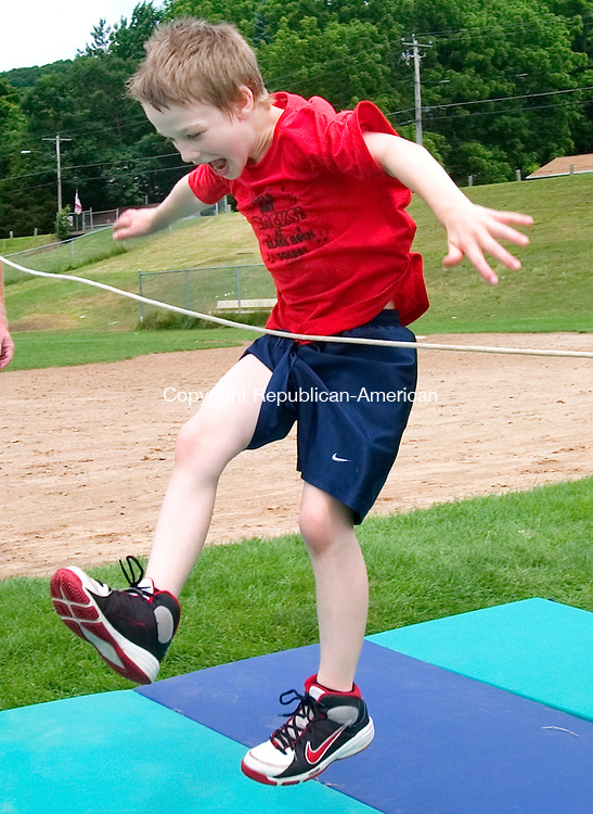 THOMASTON, CT. 15 June 2010-061510SV03--Ryan Szymanski, 8, just missed the high jump during field day at Black Rock School in Thomaston Monday. The whole school participated about 362 students.<br /> Steven Valenti Republican-American