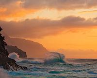 Kauai, Hawaii<br /> Surf and waves pound the rocky cliffs of the Na Pali coast near Ke'e Beach