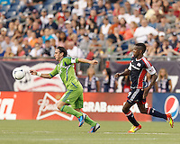 Seattle Sounders FC midfielder Mauro Rosales (10) controls the ball as New England Revolution midfielder Clyde Simms (19) closes. In a Major League Soccer (MLS) match, the New England Revolution tied the Seattle Sounders FC, 2-2, at Gillette Stadium on June 30, 2012.