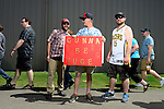 Rocky Toussant of Bellingham holds a homemade sign while walking into a rally by Republican Presidential Candidate Donald Trump in Lynden, Washington at the Northwest Washington Fairgrounds Saturday May 7, 2016. A reported 5,000 people attended the event, which attracted considerable protest ahead of the planned 3 p.m. speech, delayed by an hour when Trump's plane was late leaving an earlier stop in Spokane. Lynden is home to about 12,000 people and was a last-minute host to the presidential candidate after the campaign had difficulty obtaining permits for a hastily planned event in Seattle, located two hours away. Photo by Daniel Berman/www.bermanphotos.com