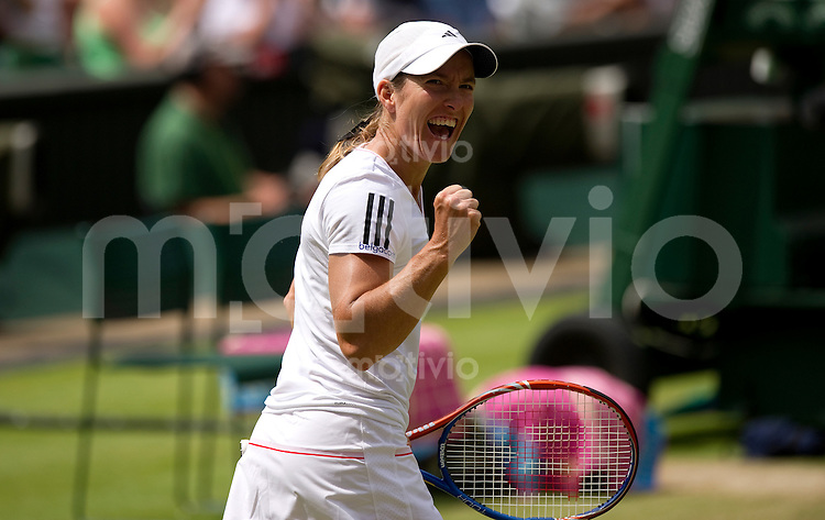 Justine Henin (BEL) plays against Nadia Petrova (RUS) on Centre Court. The Wimbledon Championships 2010 The All England Lawn Tennis & Croquet Club  Day 5 Friday 25/06/2010