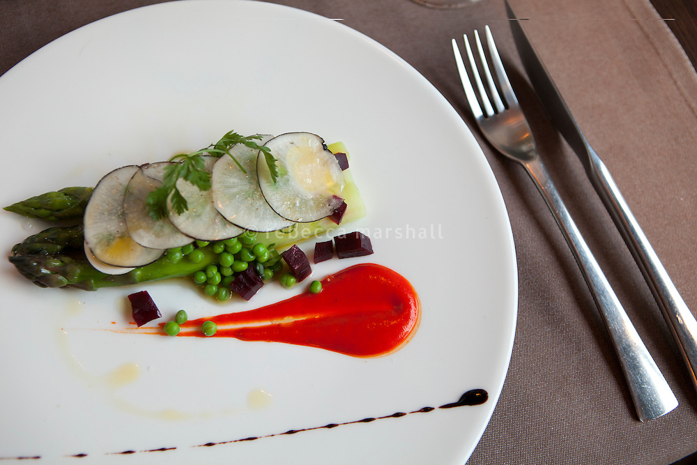 A starter of asparagus, quail eggs, peas, beetroot and black radish with a red pepper sauce served at L'Armoise restaurant, Antibes, France, 07 April 2012. Chef Laurent Parrinello changes his menu weekly according to the fresh produce available at the nearby market.