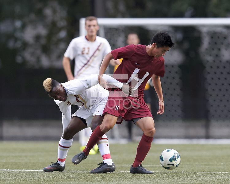 Boston College midfielder Derrick Boateng (10) and Harvard University midfielder Andrew Chang (11) battle for the ball. Boston College (white) defeated Harvard University (crimson), 3-2, at Newton Campus Field, on October 22, 2013.
