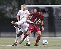 Boston College midfielder Derrick Boateng (10) and Harvard University midfielder Andrew Chang (11) battle for the ball. Boston College (white) defeated Harvard University (crimson), 3-2, at Newton Campus Field, on October 22, 2013.