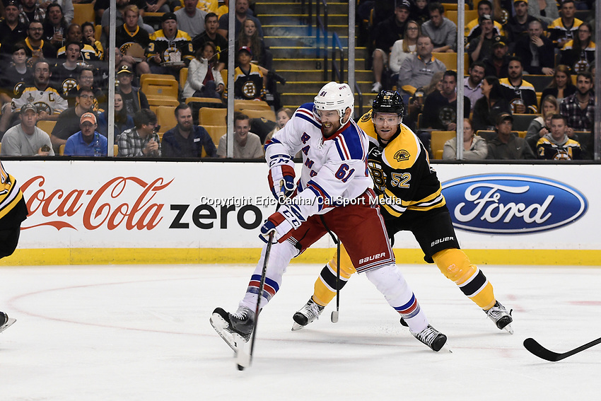 September 24, 2015 - Boston, Massachusetts, U.S. - New York Rangers left wing Rick Nash (61) takes a shot with Boston Bruins defenseman Matt Irwin (52) closing in during the NHL game between the New York Rangers and the Boston Bruins held at TD Garden, in Boston, Massachusetts. Eric Canha/CSM